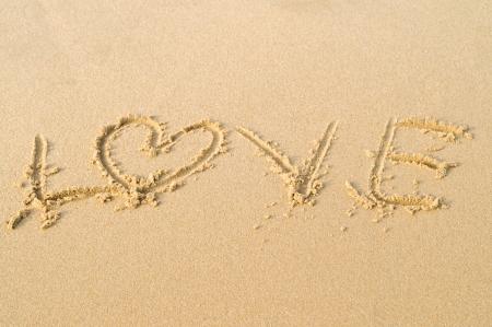 Write love on sand texture