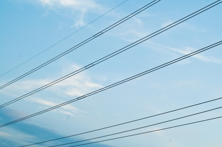 Wires and white cloud with blue sky photo
