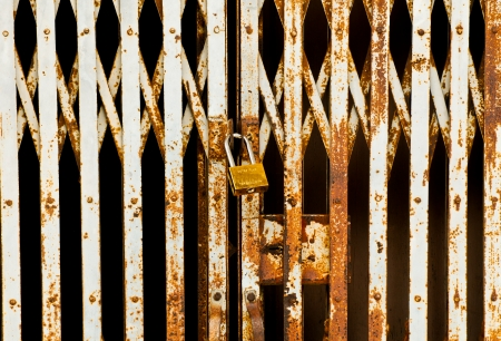 Steel gate and lock with black and brown background photo