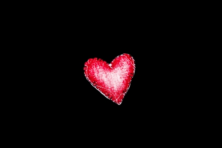 Red heart with black background photo