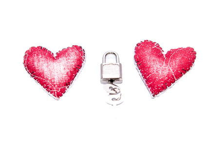 Red heart and key with white background photo