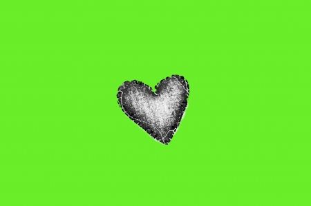 Black heart with green background photo