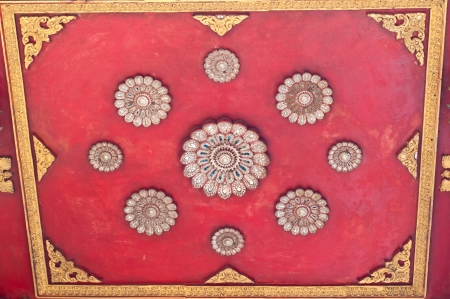 Ancient red  ceiling at temple with red backgroud photo