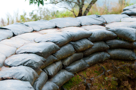 esbjerg: Sand bag bunker with green background Stock Photo