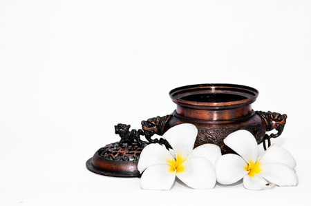 Ancient container with flower and lion on top Stock Photo