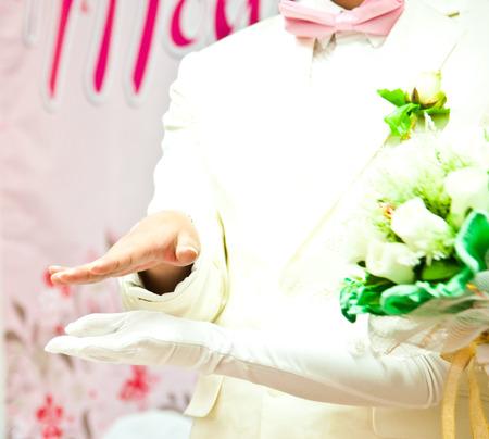 Groom grabs brides hand on wedding day