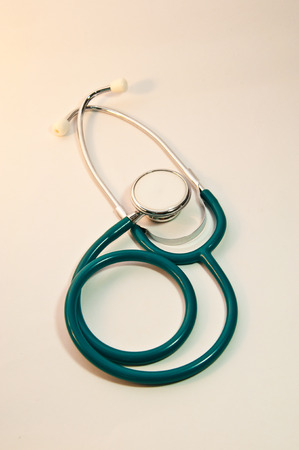 Stethoscope and hand with white background