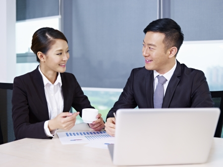 asian business executives discussing business in office  Stock Photo - 17974999