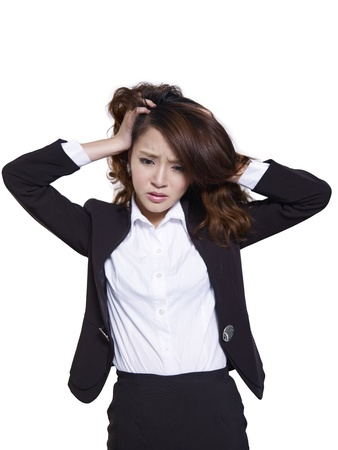 distraught: portrait of a distraught asian businesswoman, isolated on white  Stock Photo
