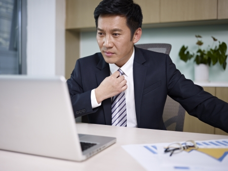 asian businessman working in office Stock Photo - 18055700