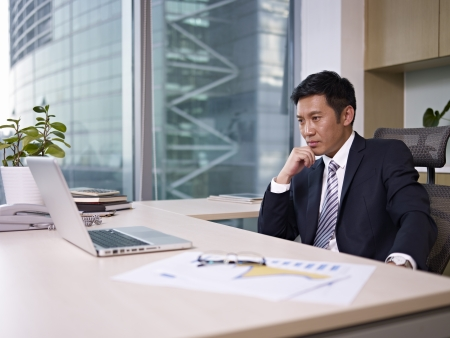 asian businessman thinking in office, looking depressed Stock Photo - 18055701