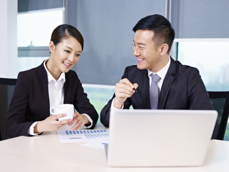 asian business people: asian business executives discussing business in office