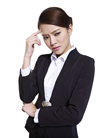 hesitating: studio portrait of a young asian businesswoman