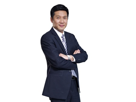 studio portrait of an asian businessman with arms crossed photo