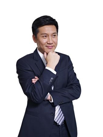 studio portrait of an asian businessman