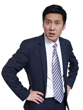 incensed: studio portrait of an angry asian businessman