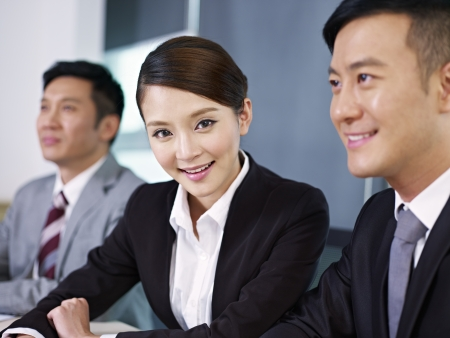 outstanding: young asian businesswoman in a meeting