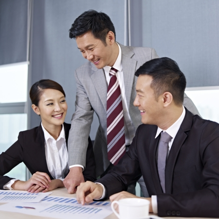 asian office lady: asian business people discussing business in office  Stock Photo