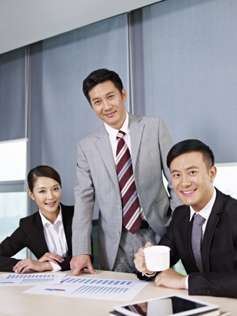 a team of asian business people working together in office  photo