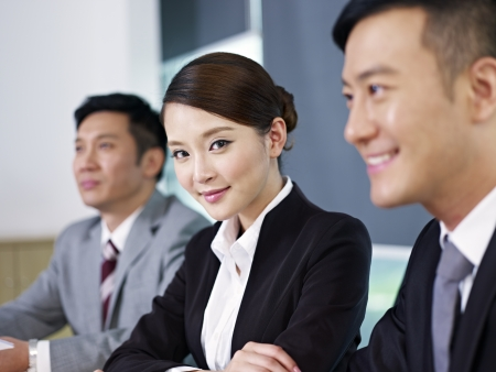 asian business people at a meeting