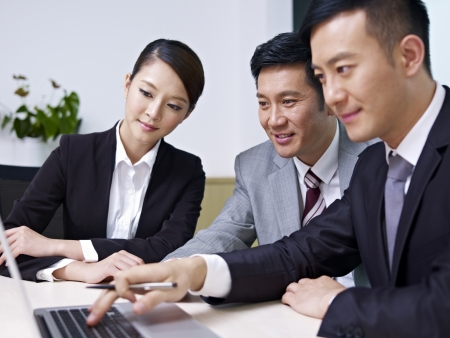 asian office lady: a team of asian business people working together in office