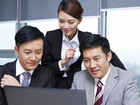 a team of asian business people working together in office