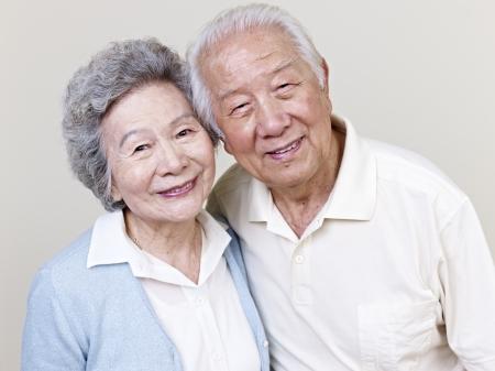 two couples: portrait of a senior asian couple