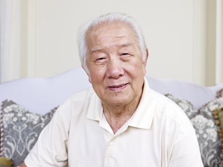 and the horizontal man: portrait of an asian senior man