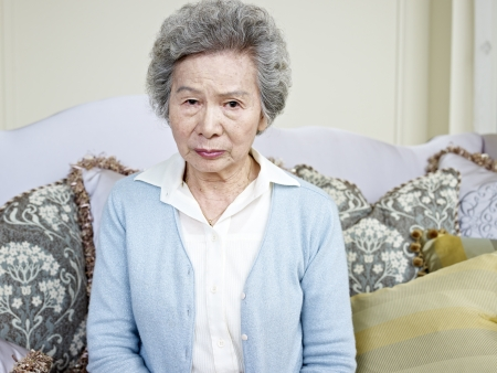 old sofa: portrait of an angry senior asian woman  Stock Photo