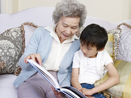 grandma and grandson reading a book together  photo