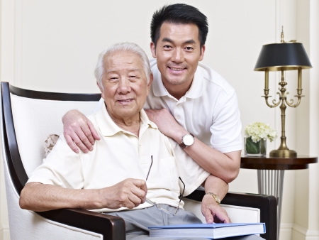 east asian: portrait of an asian senior and his adult son