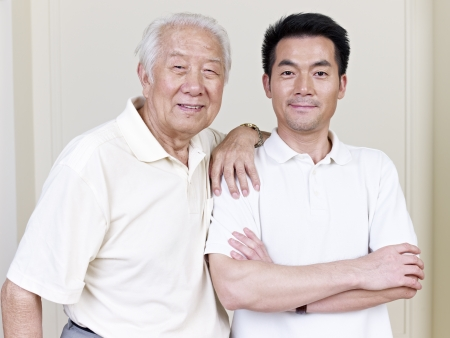 supportive: portrait of asian father and son  Stock Photo