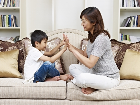 asian mother and son having fun at home  photo