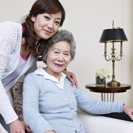 relationship mother and daughter: senior asian woman and her adult daughter  Stock Photo