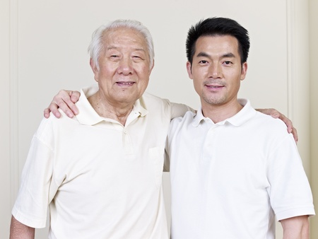 portrait of asian father and son  photo