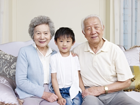 portrait of grandparents and grandson photo