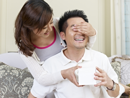 husbands: wife giving surprise present to husband