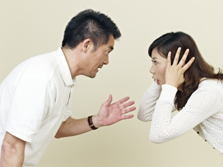 bad temper: young asian couple having an argument