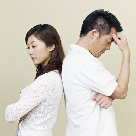young asian couple having relationship difficulties  photo