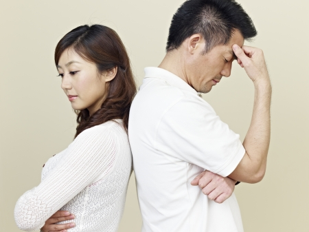 difficulties: young asian couple having relationship difficulties  Stock Photo