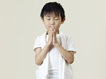 a boy: six year old little asian boy praying