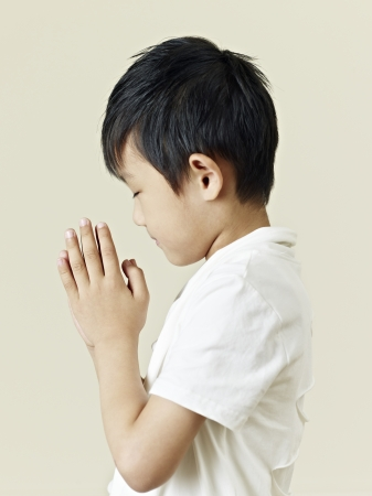 six year old little asian boy praying  photo