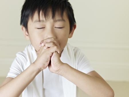 birthday religious: six year old little asian boy praying