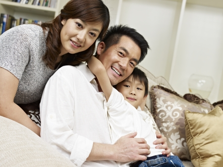 portrait of an asian family of three  photo