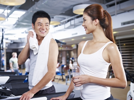 partners: young man and woman talking during a break in gym