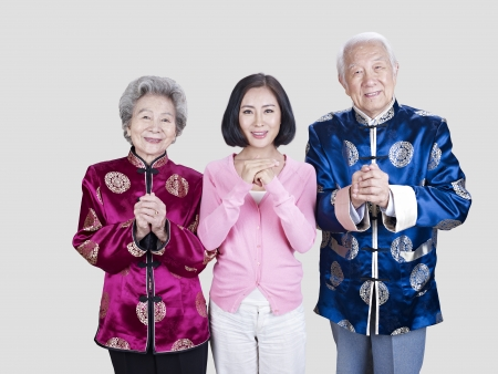 cai: portrait of a senior asian couple and their adult daughter