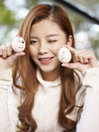 asian girl with love eggs, valentine photo