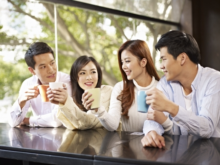 enjoy life: young friends talking and drinking coffee in cafe  Stock Photo