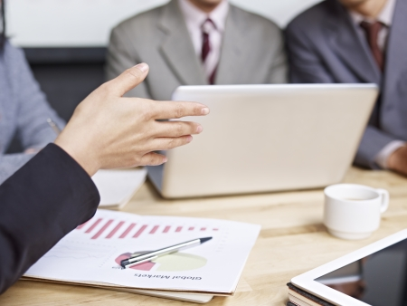 business people reviewing sales performance in a meeting  photo