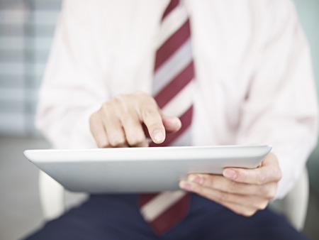 businessman touching screen of a tablet computer  photo